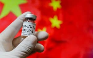 China Yields to Pressure and Agrees to Approve First Foreign COVID-19 Vaccine by July